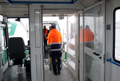 Passenger helped boarding a plane from the ambulift