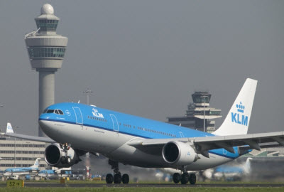 KLM airplane landing at Amsterdam Schiphol airport